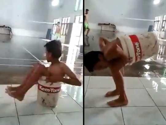 boy stuck in bucket