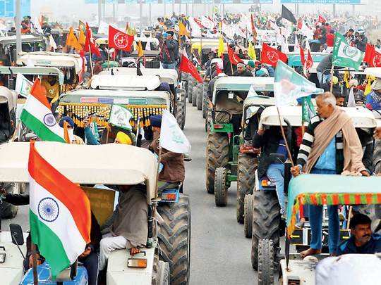 Farmers participate in a tractor rally
