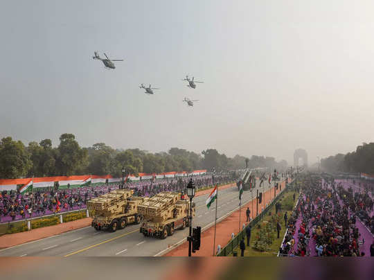 New Delhi: Dhruv Helicopters fly past Rajpath during the full dress rehearsal fo...