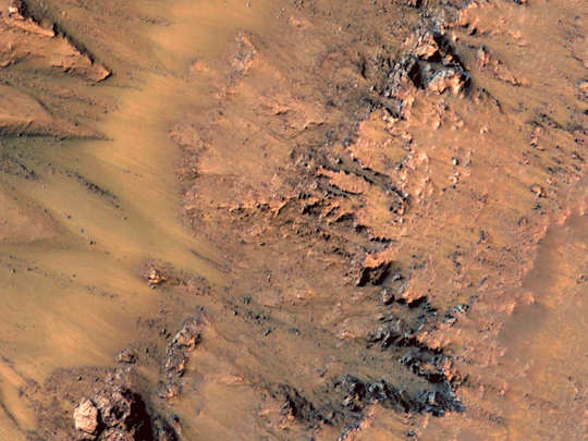 ice under martian surface causing sinkholes and landslides