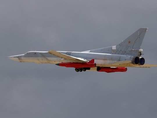 russia nuclear bomber tu-22m3 fires kh-32 supersonic air launched cruise missile, us aircraft carrier on target