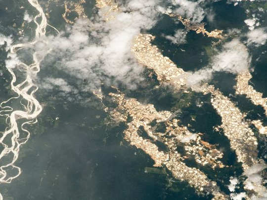 illegal gold mining and deforestation in peru comes to light as iss astronaut clicks golden amazon river