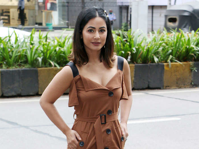 hina khan raises the temperature with her pics in pixel coat and short dress