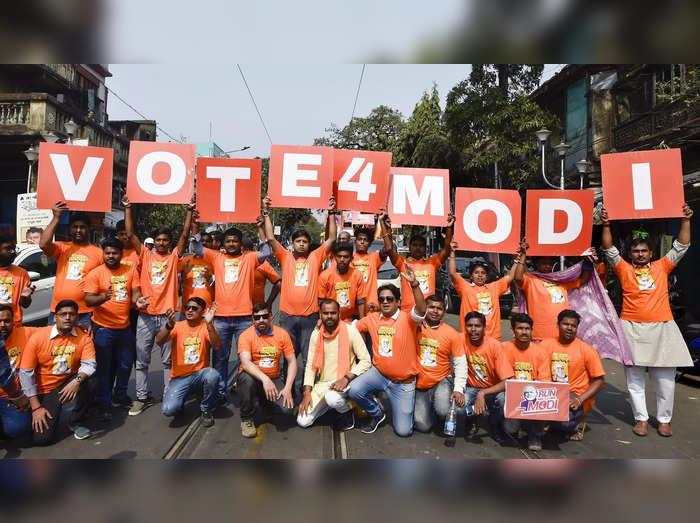 Kolkata: BJP activists take part inthe Run for Modi rally in Kolkata. (PTI Pho...