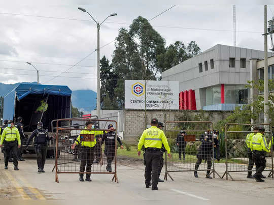 Police set up barricades outside the offices of the Forensic Medicine and Forensic Science institute after the bodies of several inmates were brought in in Cuenca
