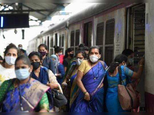 Mumbai: Women passengers deboard a local train after the authorities allowed the...