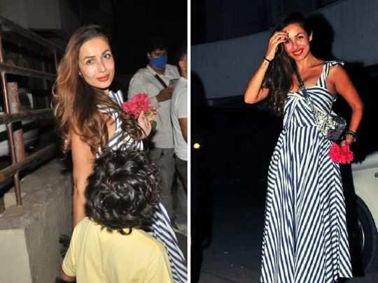 malaika arora looks fresh and glamorous in striped dress while accompanying arjun kapoor to kareena house