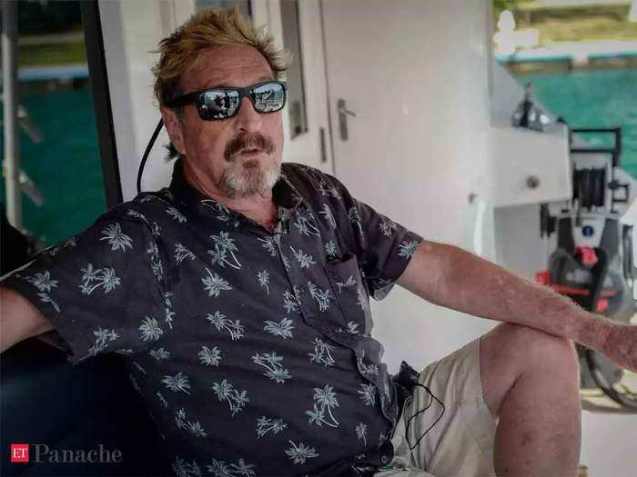 mcafee software icon john mcafee charged in cryptocurrency scam
