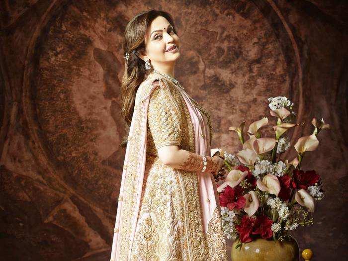 from pink lehenga to black embellished suit nita ambani always a stylish wedding guest