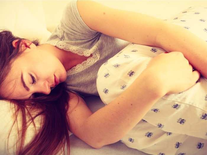 suffering from period cramps here are 3 best sleeping positions for relief