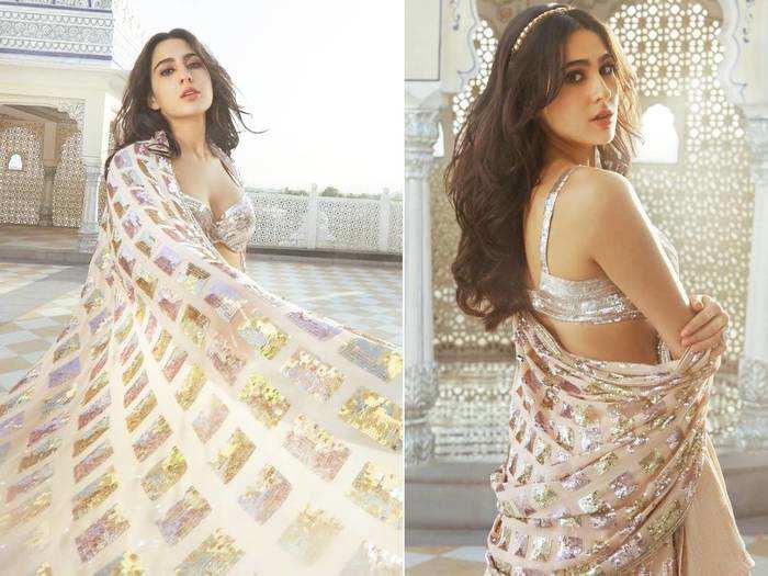 sara ali khan brutally trolled for showing her back in silver lehenga by manish malhotra