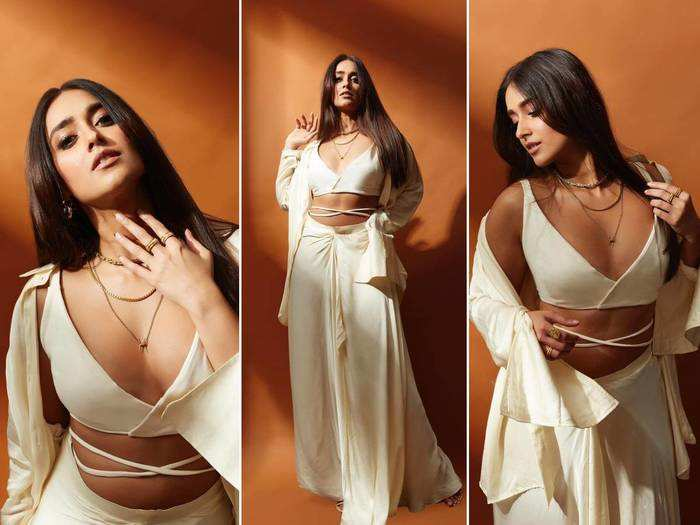 ileana dcruz is making the temperatures soar in a white bralette top and pleated skirt