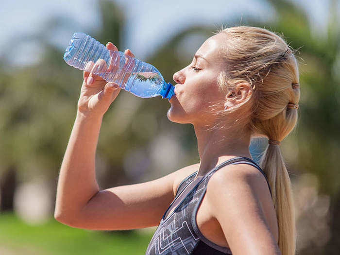 what are the side effects of drinking water while standing in marathi