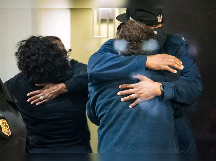 People embrace after learning that their loved one was safe after a mass casualty shooting at the FedEx facility in Indianapolis
