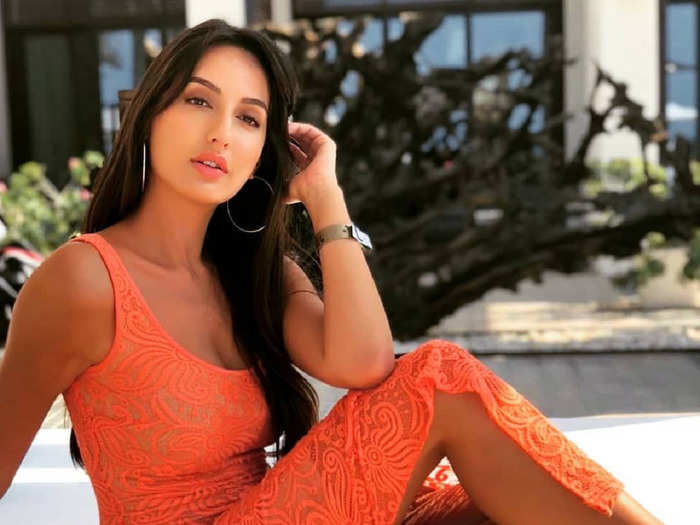 nora fatehi stuns in alex perry orange bodycon dress