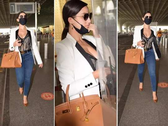 nora fatehi trolled for her bold black colour semi sheer corset top look at airport in marathi