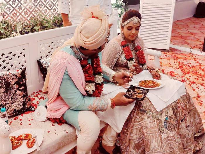 groom dr sanket bhosale feeds her bride sugandha mishra at a hotel in punjab photos go viral