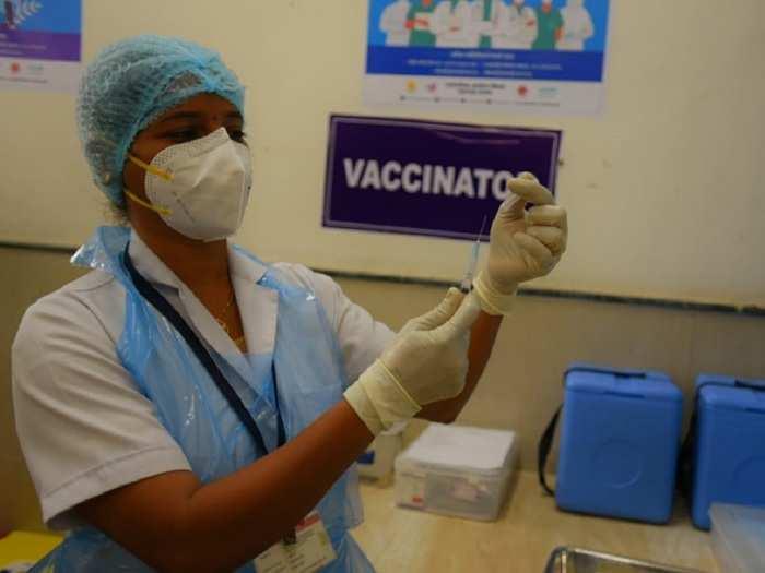 Nurse holding a vaccine.