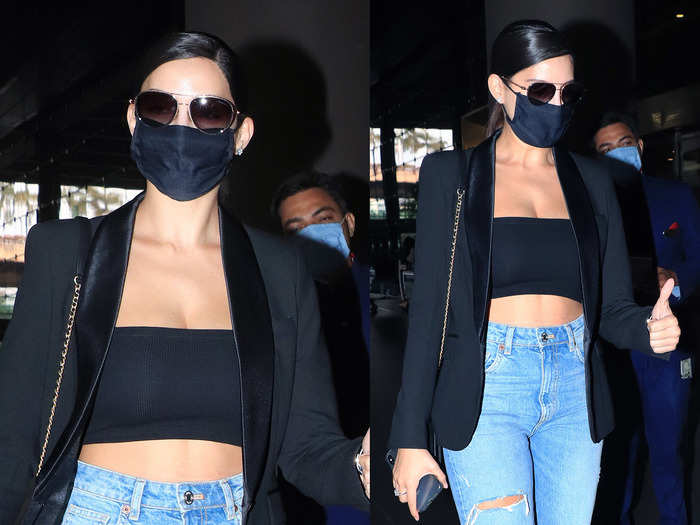 nora fatehi in tube top and ripped jeans aces the airport look