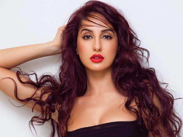 nora fatehi looks super hot in black transparent dress at vogue beauty awards 2018