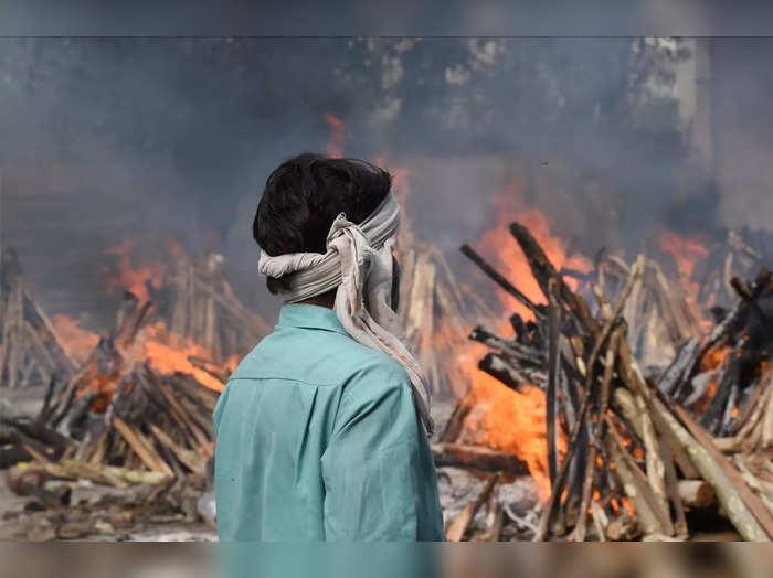 New Delhi: Mass cremation at Ghazipur cremation ground as coronavirus cases surg...