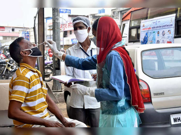 Amravati: A health worker collects samples for COVID-19 testing, amid surge in c...