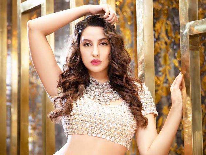 nora fatehi looks sensuous in pearl blouse and chikankari lehenga by abu jani sandeep khosla