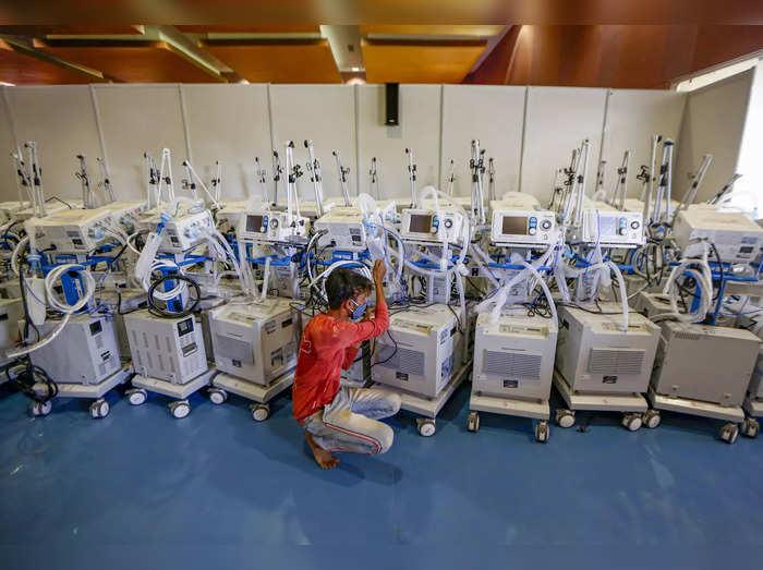 Ahmedabad: A worker checks ventilators inside the 900 bed COVID-19 hospital at C...