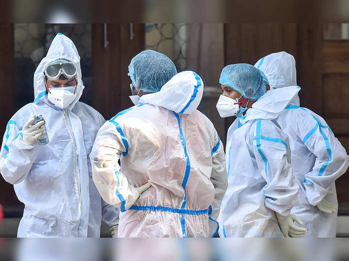 Kolkata: Workers wearing PPE suits outside a State Government run Covid Hospital...