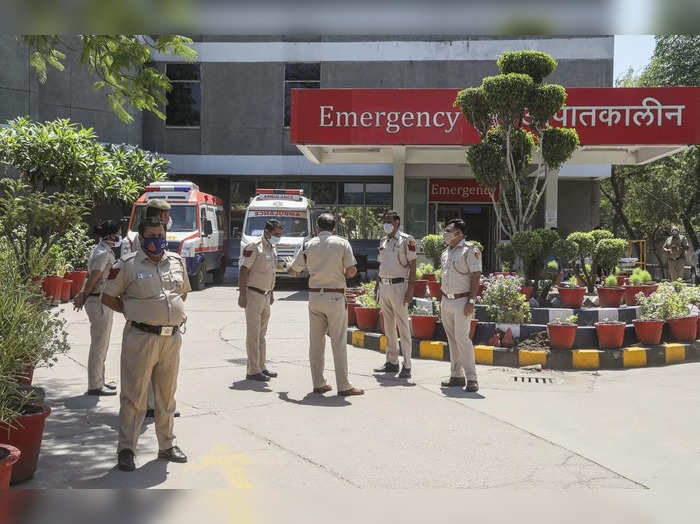 New Delhi: Police personnel look on after atleast 20 critically COVID 19 patient...