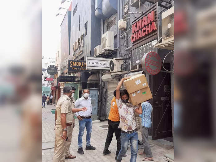 New Delhi: Police personnel during a raid at Khan Chacha restaurant, in which bo...