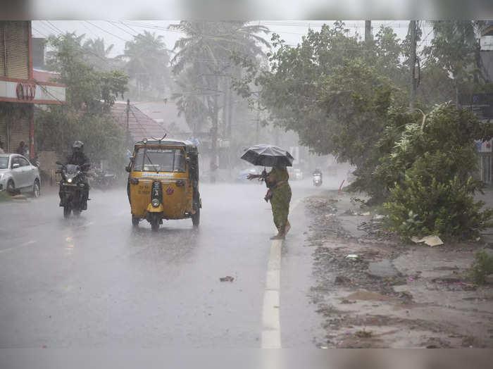 Vehicles ply during rain