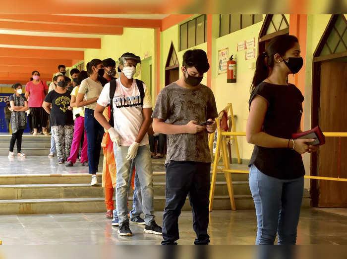 Jabalpur : Benefiaciers wait in a queue for COVID-19 vaccine dose, at Gyan Ganga...