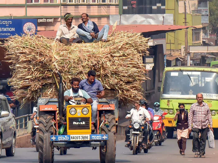 Hubballi: Farmers carry fodder on a tractor in Hubballi. Various farmers unions...