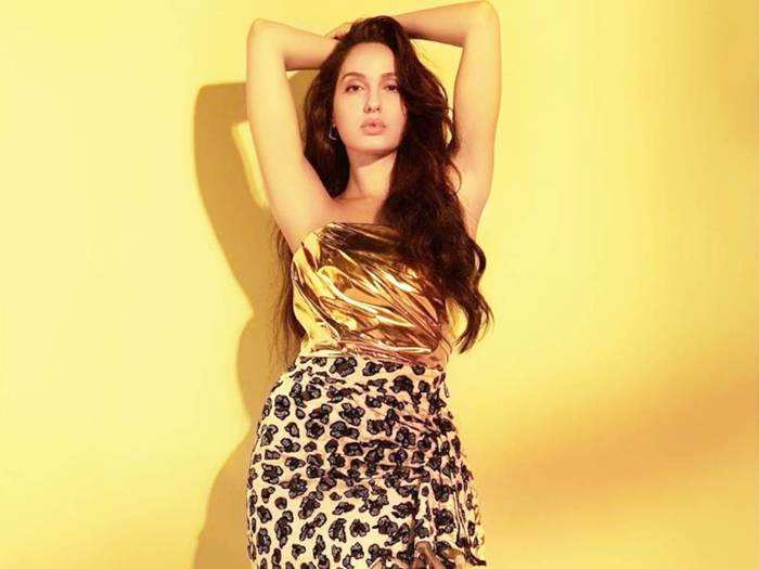 nora fatehi looks fabulous in leopard print dress and belt by roberto cavalli for chod denge song