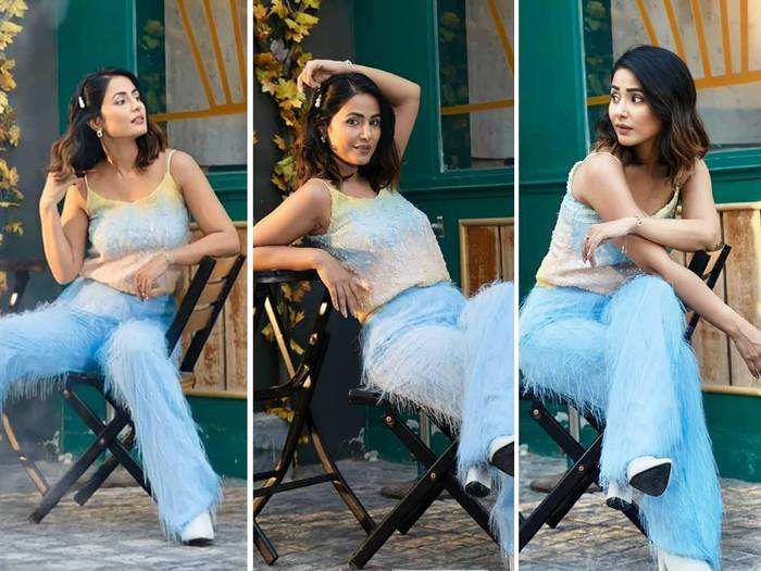hina khan looks worst in blue flared trousers and white spaghetti top