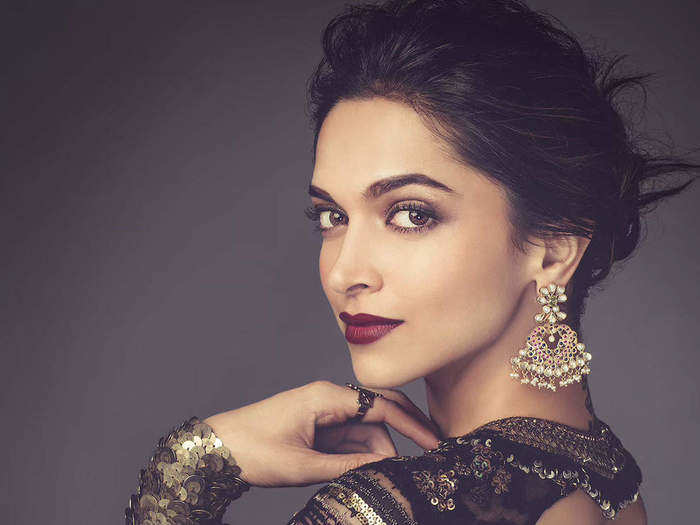 deepika padukone red velvet lehenga outfit with golden embroidery work