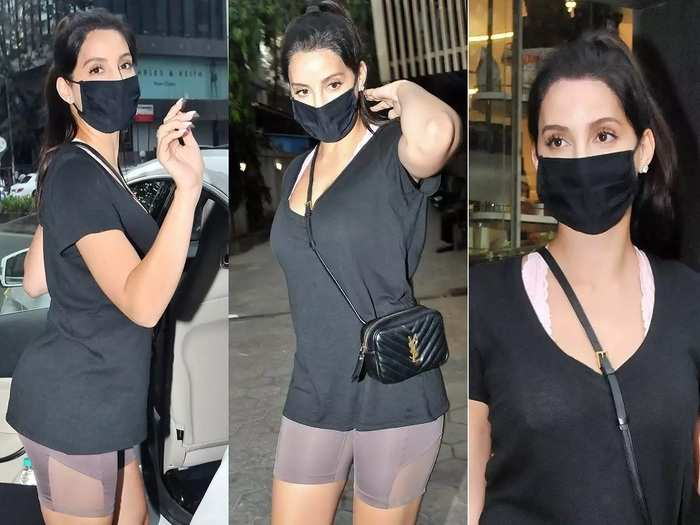 nora fatehi wore stylish black color t shirt with cycle shorts but her look fails to impress fans in marathi