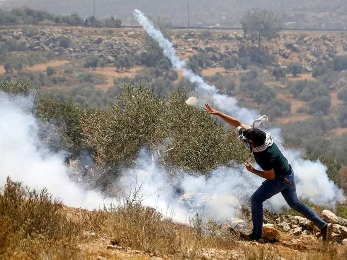 Palestinians protest against Israeli settlements, in West Bank.