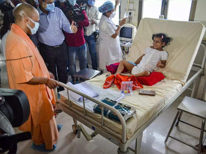 Gorakhpur: Uttar Pradesh Chief Minister Yogi Adityanath inspects the paediatric ...