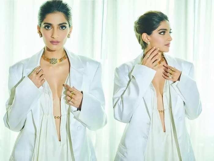 sonam kapoor in expensive white waist tie up top paired with silver pleated skirt see her beautiful photos in marathi