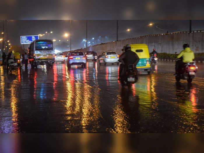 New Delhi: Vehicles ply amid rains in New Delhi. (PTI Photo/Manvender Vashist) ...