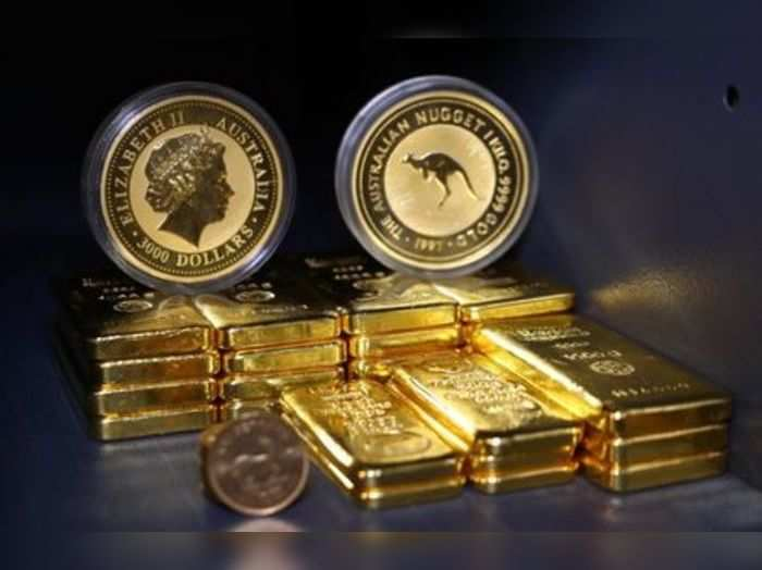 Gold bars and coins are stacked in the safe deposit boxes room of the Pro Aurum gold house in Munich