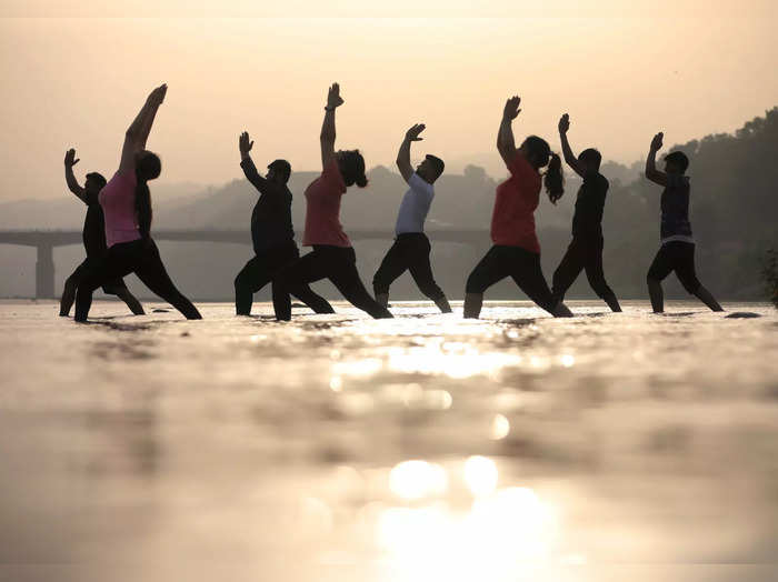 Jammu: Youngsters practice yoga as part of preparations ahead of International Y...