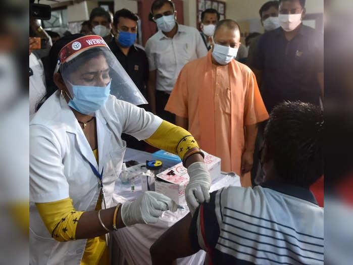 Lucknow: Uttar Pradesh Chief Minister Yogi Adityanath visits a Covid-19 vaccinat...