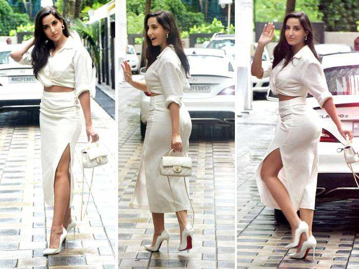 nora fatehi looks sizzles in a thigh slit skirt and white crop top with 5 lakh chanel handbag