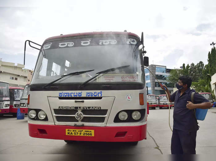 Bengaluru: A worker sprays disinfectants on a state road transport bus ahead of ...