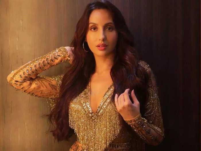nora fatehi wore monochromatic off shoulder mermaid gown show stopper for gauri and nainika at lakme fashion week