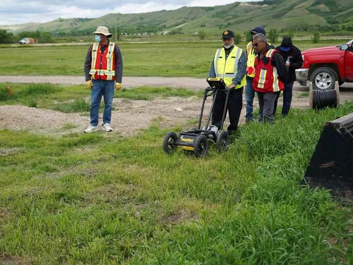A crew performs a ground-penetrating radar search of a field near the former Marieval Indian Residential School in Grayson.
