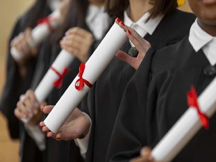 close-up-people-graduating-with-diplomas_23-2148950541